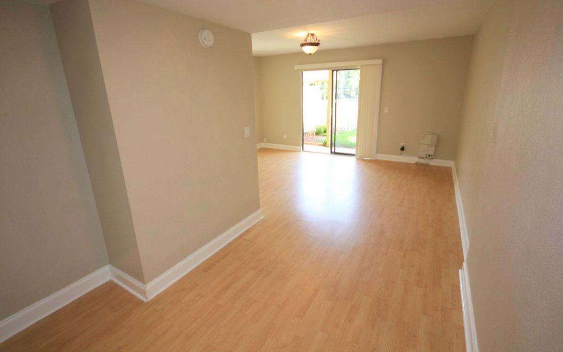 Living room has laminate floors